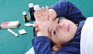 dolor de cabeza, tos y náuseas